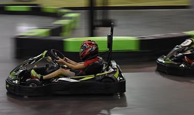 Kid riding a go kart