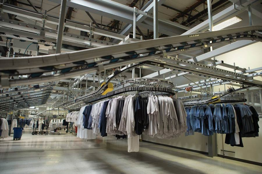 Aramark Laundry building interior clothes on rack