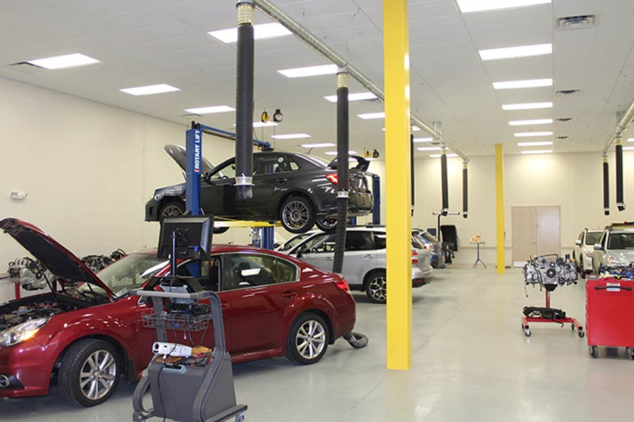 Suburu Building interior mechanical garage with cars
